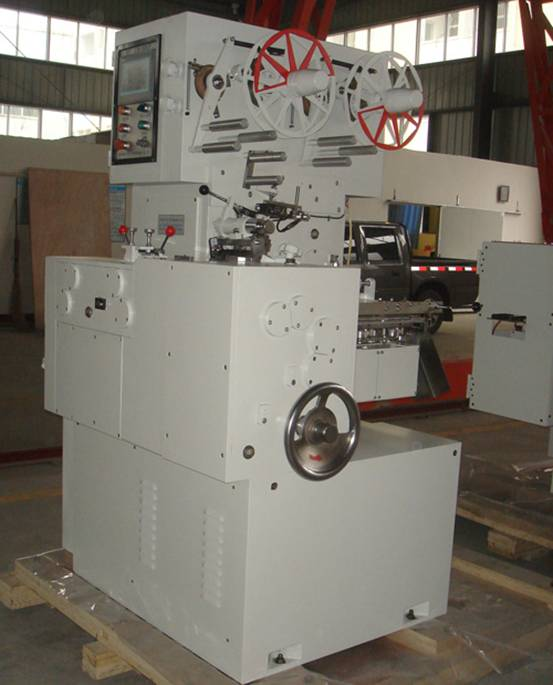 wrapping machine is for the shaping, cutting and packaging of bubble gum and chewy candy with rectangular shape